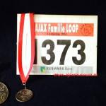 Mediale en certificaat Ajax Familie Loop 4 augustus 1996. De familieloop was van het oude Ajax-stadion in De Meer, Watergraafsmeer, naar het nieuwe Ajax-stadion, de Amsterdam Arena.